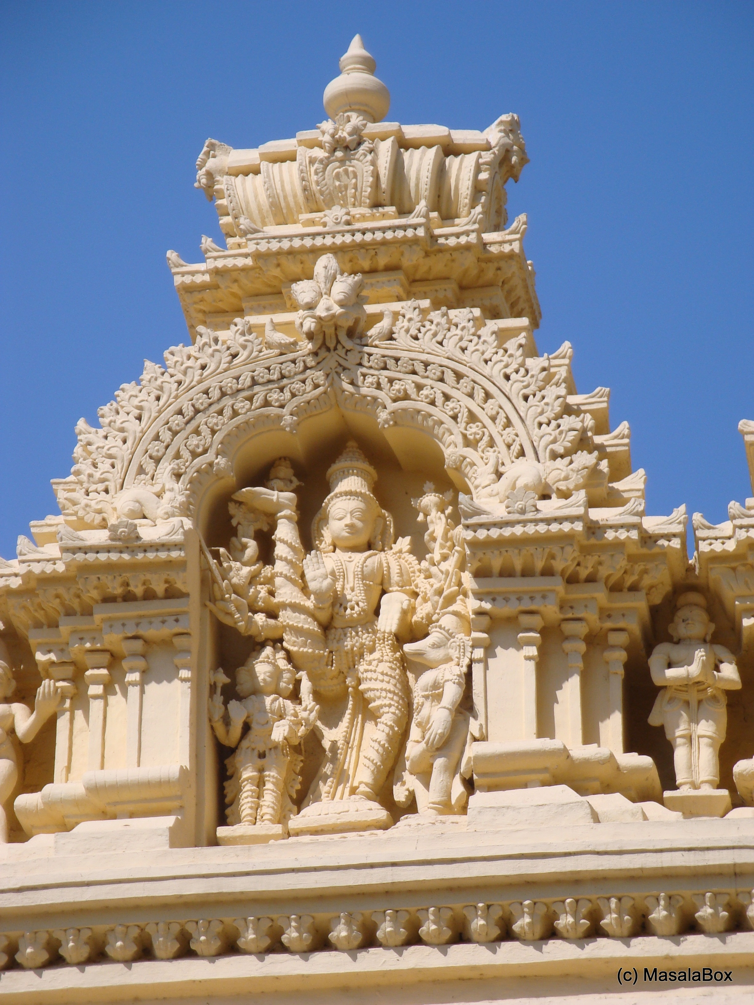 One of the carvings atop the mandapam
