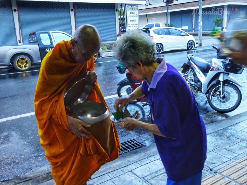 Giving alms to Buddhist monks